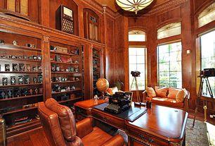 Traditional Home Office with Crown molding, flush light, Hardwood floors, Art desk, Casement, Built-in bookshelf, Carpet