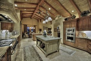 Eclectic Kitchen with Simple granite counters, Stone Tile, Cathedral ceiling, Custom hood, Kitchen island, Exposed beam