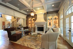 Traditional Living Room with Box ceiling, can lights, Transom window, Crown molding, High ceiling, French doors, Columns