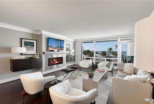 Contemporary Living Room with Hardwood floors, Glass panel door, metal fireplace