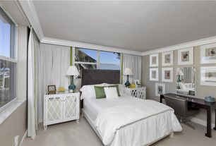 Contemporary Guest Bedroom with Crown molding, Concrete floors