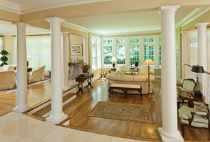 Traditional Living Room with double-hung window, Columns, Crown molding, Hardwood floors, Sunken living room, French doors