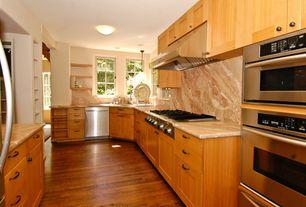 Modern Kitchen with Standard height, Flat panel cabinets, Hardwood floors, Complex Granite, Pendant light, Undermount sink