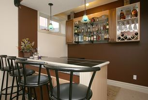 Modern Bar with Standard height, stone tile floors, picture window, Built-in bookshelf, Pendant light