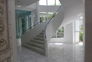 Modern Staircase with picture window, soapstone tile floors, Carpet, Spiral staircase, High ceiling, can lights