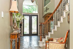 Traditional Entryway with Pendant light, Concrete tile , High ceiling, French doors, Arched window, Transom window