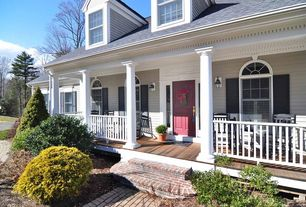 Traditional Porch with Covered front porch, exterior brick floors, specialty window, Arched window, six panel door