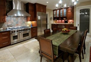 Eclectic Kitchen with Concrete tile , Metal Tile, can lights, single dishwasher, Standard height, Breakfast nook, Wall Hood