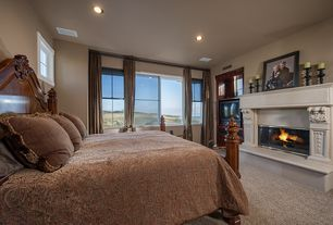 Traditional Guest Bedroom with other fireplace, Carpet, Standard height, double-hung window, Casement, can lights, Fireplace