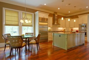 Traditional Kitchen with full backsplash, Laminate floors, electric cooktop, Breakfast nook, Casement, Crown molding