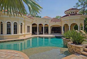 Mediterranean Swimming Pool with Arched window, exterior tile floors