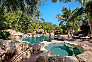 Tropical Swimming Pool with Pool with hot tub, exterior stone floors, Fence
