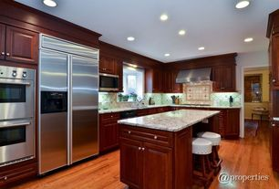 Traditional Kitchen with can lights, Breakfast bar, electric cooktop, Undermount sink, Raised panel, Hardwood floors