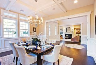 Traditional Dining Room with High ceiling, Carpet, Chandelier, Hardwood floors, Exposed beam, Wainscotting