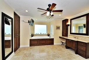 Traditional Master Bathroom with Casement, Raised panel, Crown molding, Ceiling fan, stone tile floors, Framed Partial Panel