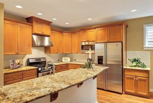 Traditional Kitchen with Kitchen island, Complex granite counters, Flat panel cabinets, Complex Granite, Hardwood floors