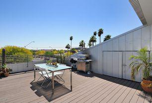Modern Deck with Outdoor kitchen, Barn door, Deck Railing