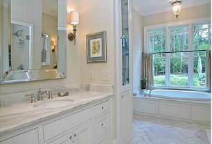 Traditional Master Bathroom with Master bathroom, Crown molding, frameless showerdoor, Wall sconce, Complex Marble