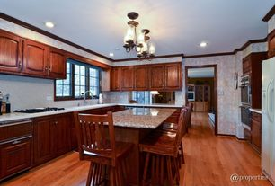 Traditional Kitchen with Onyx, Simple granite counters, L-shaped, Framed Partial Panel, double wall oven, flush light