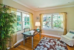 Eclectic Home Office with Chair rail, Laminate floors, Standard height, Crown molding, double-hung window