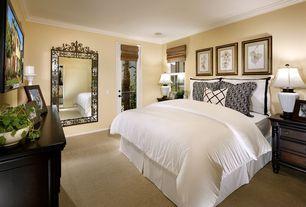 Traditional Guest Bedroom with Crown molding, Carpet, Glass panel door