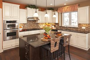 Traditional Kitchen with Glass Tile, Hardwood floors, L-shaped, Simple granite counters, Breakfast bar, Raised panel