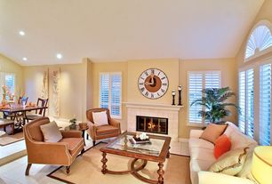 Traditional Great Room with Chiatali Border Natural Jute Area Rug, Carpet, Arched window, Sunken living room, Concrete tile