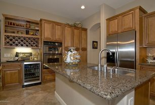 Eclectic Kitchen with Concrete tile , L-shaped, Kitchen island, Undermount sink, Wine refrigerator, Raised panel
