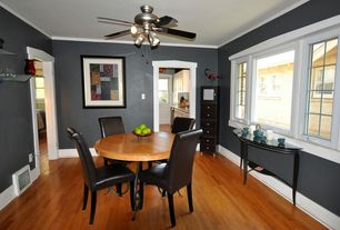 Modern Dining Room with Ceiling fan, Standard height, Laminate floors, Hardwood floors, picture window, Casement