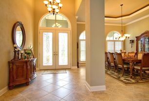 Traditional Entryway with Chandelier, High ceiling, picture window, Carpet, Glass panel door, Crown molding, Arched window