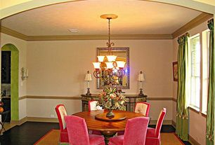 Traditional Dining Room with Chair rail, Crown molding, Chandelier, Hardwood floors
