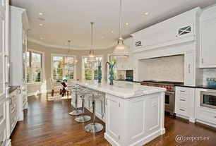 Traditional Kitchen with Flat panel cabinets, Onyx, Breakfast nook, Daltile aura silver cloud harlequin tile, Custom hood