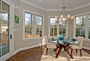 Contemporary Dining Room with Hardwood floors, Chandelier, French doors, Crown molding