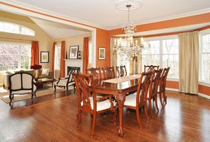 Traditional Dining Room with Chandelier, Standard height, Laminate floors, Crown molding, Casement