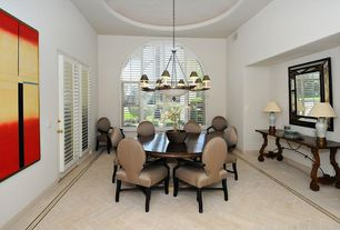 Eclectic Dining Room with herringbone tile floors, Louvered door, Arched window, Chandelier, High ceiling