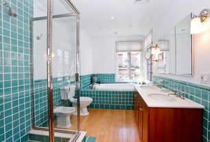 Modern Master Bathroom with European Cabinets, Wall sconce, Double sink, Chair rail, Large Ceramic Tile, Laminate floors