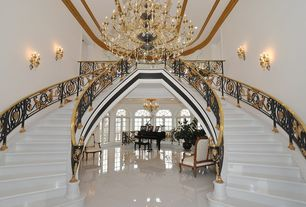 Traditional Staircase with Wall sconce, Chandelier, Crown molding, Double staircase, High ceiling, sandstone floors