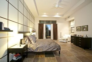 Modern Guest Bedroom with High ceiling, Ceiling fan, sliding glass door, can lights, stone tile floors