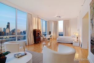 Contemporary Master Bedroom with Standard height, flush light, Hardwood floors, picture window