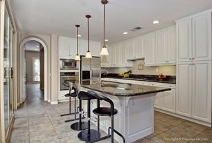 Traditional Kitchen with Kitchen island, Standard height, partial backsplash, L-shaped, Breakfast bar, stone tile floors