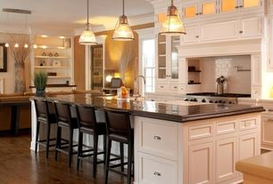 Traditional Kitchen with electric cooktop, Breakfast bar, six panel door, White subway tile, Glass panel, Pendant light