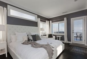 Contemporary Guest Bedroom with Pottery Barn Lorraine Tufted Tall Headboard & Bed, Hardwood floors, Louvered door