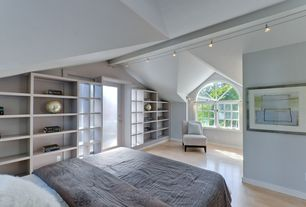Contemporary Guest Bedroom with Pendant light, Built-in bookshelf, Laminate floors, French doors, Arched window