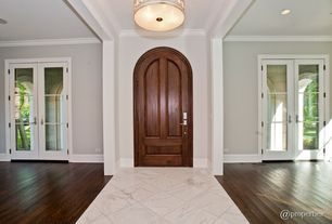 Traditional Entryway with Standard height, can lights, French doors, Concrete tile , six panel door, Hardwood floors