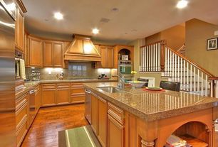 Traditional Kitchen with Breakfast bar, High ceiling, Undermount sink, Simple Granite, L-shaped, Flat panel cabinets
