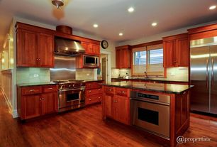 Traditional Kitchen with Undermount sink, Concrete counters, full backsplash, Built In Refrigerator, Kitchen island, L-shaped