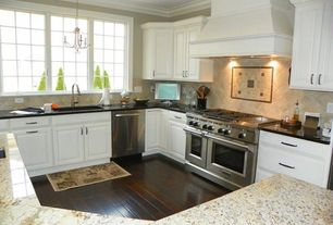 Traditional Kitchen with Crown molding, Custom hood, Chandelier, Simple granite counters, L-shaped, Kitchen island