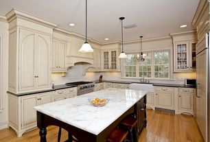 Traditional Kitchen with gas range, Soapstone counters, Built In Panel Ready Refrigerator, Pendant light, Glass panel