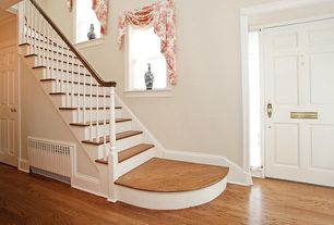 Traditional Staircase with Floating staircase, Hardwood floors, six panel door, High ceiling, Casement