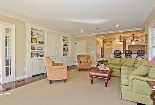 Traditional Living Room with Crown molding, Built-in bookshelf, Laminate floors, Carpet, Pendant light, Wainscotting